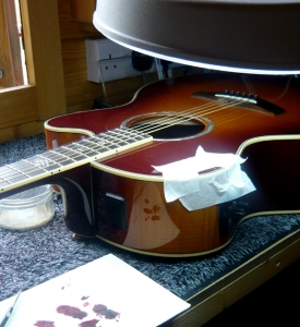 Dent repair to acoustic www.guitarlodge.co.uk