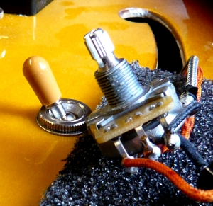 Pickups, electronic repairs & modifications: new control pot being installed on Gibson 335