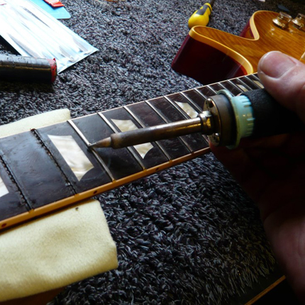 Removing frets using heat: