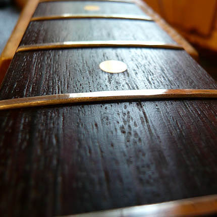 This fingerboard needs re-fretting: