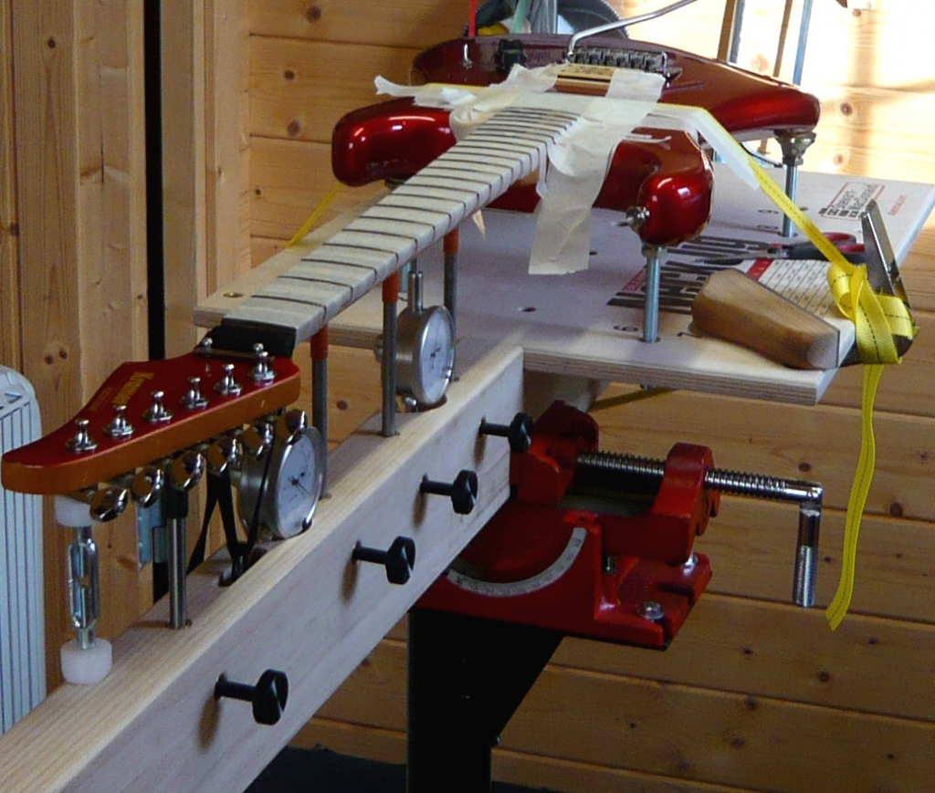 Kramer guitar being fret dressed on the Stewmac neck jig