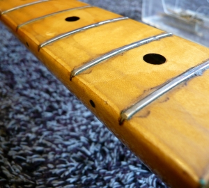 re-fretting & fret dress: Maple finger board with worn frets that need replacing.