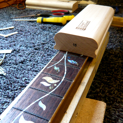 Smoothing off a fingerboard: